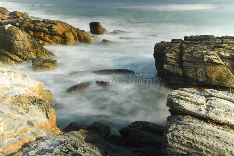 Rocks and the sea. With Long Exposure. Took the photo in Huidong, Guangdong, China stock image