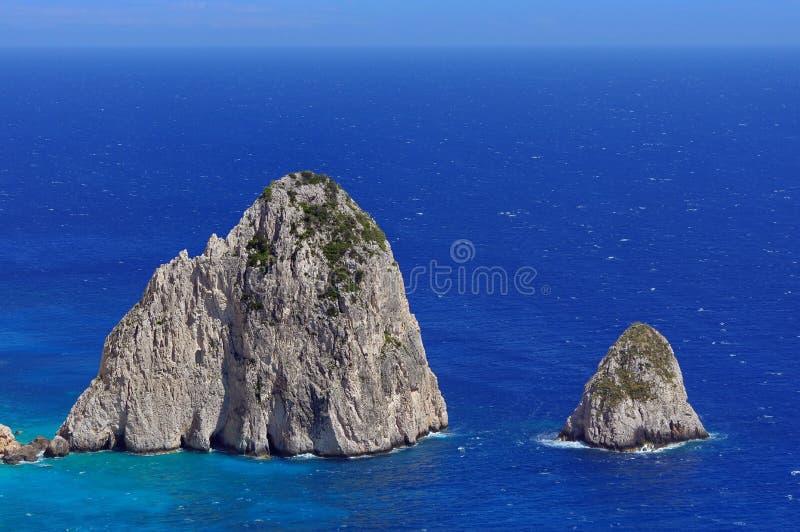 Summer landscape. Rocks in sea water - Ionian Sea, Zakynthos Island, landmark attraction in Greece. Seascape stock image