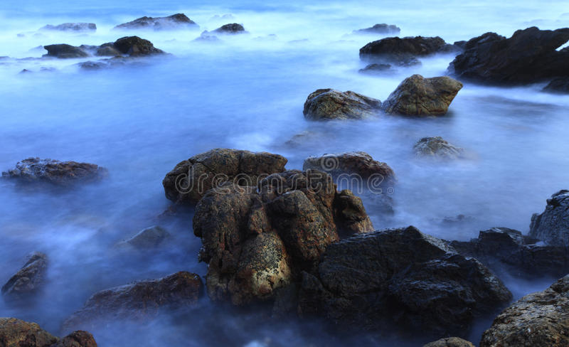Download Rocks In The Sea Wave At Dawn Moment Stock Image - Image: 26008391