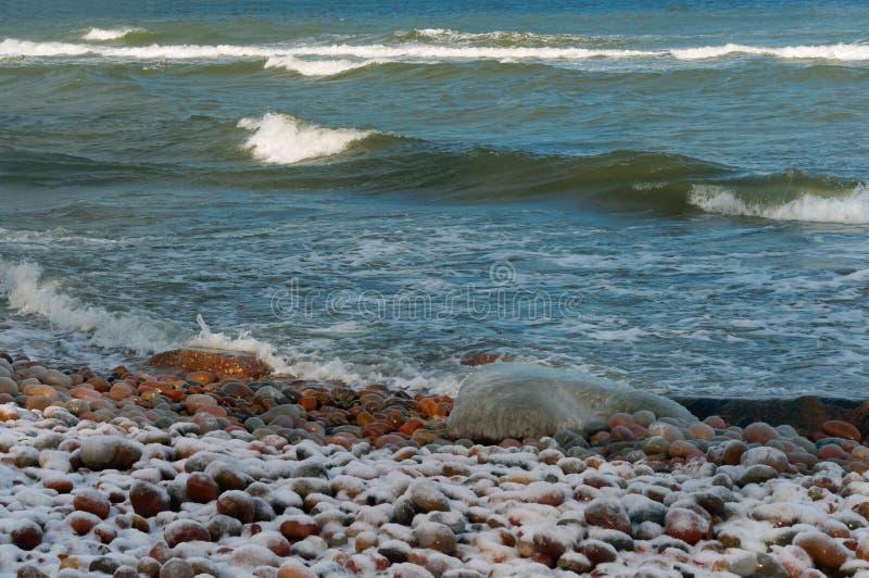 Rocks and sea waves, rocky seashore. Rocky seashore, rocks and sea waves royalty free stock photography