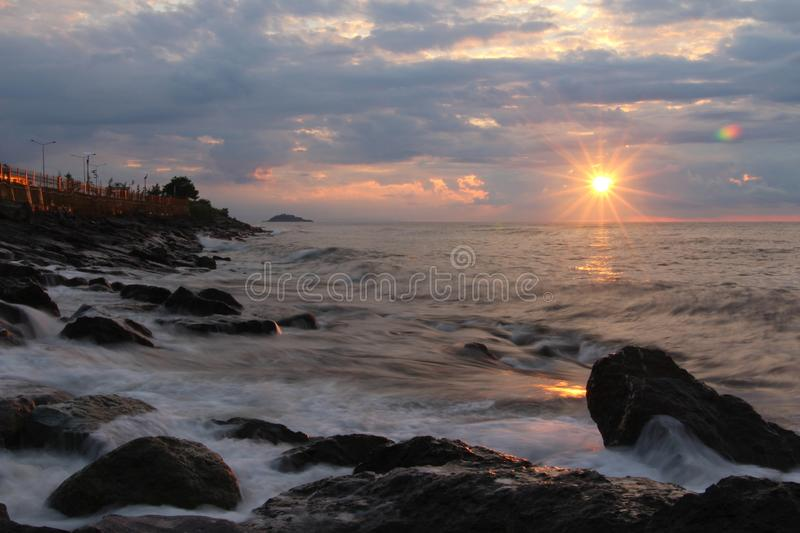 Rocks on Seashore during Sunset stock images