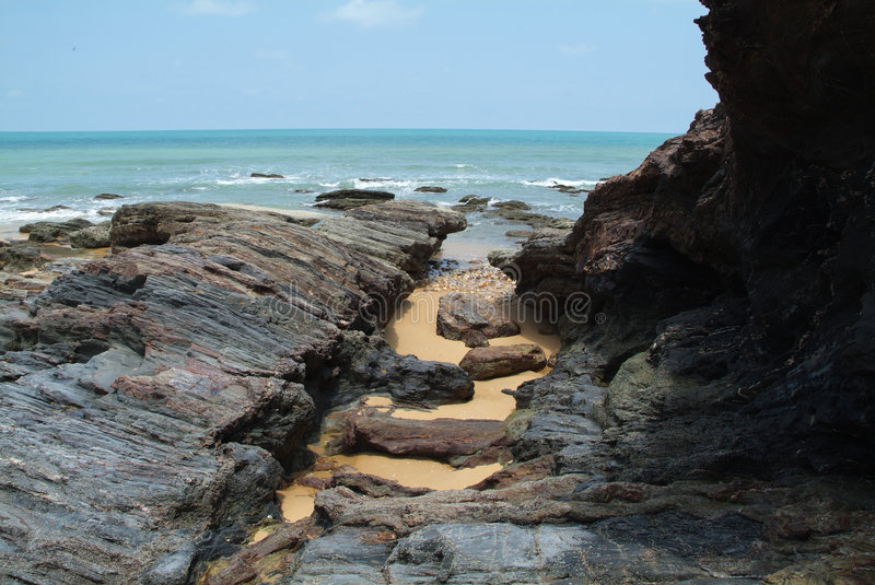 Rocks by the seaside. Rocky surfaces by the seaside in Marang, Terengganu, Malaysia royalty free stock images