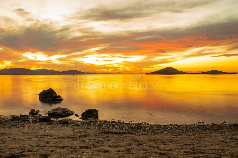 Lonely rocks during a sunset in Spain stock images