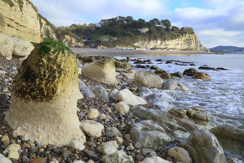 Rocks on the shingle beach. Near village of Beer in Devon royalty free stock photos