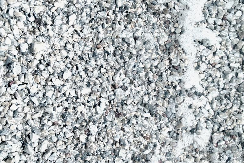 Rocks and shingles , water and marine moments 3 stock images