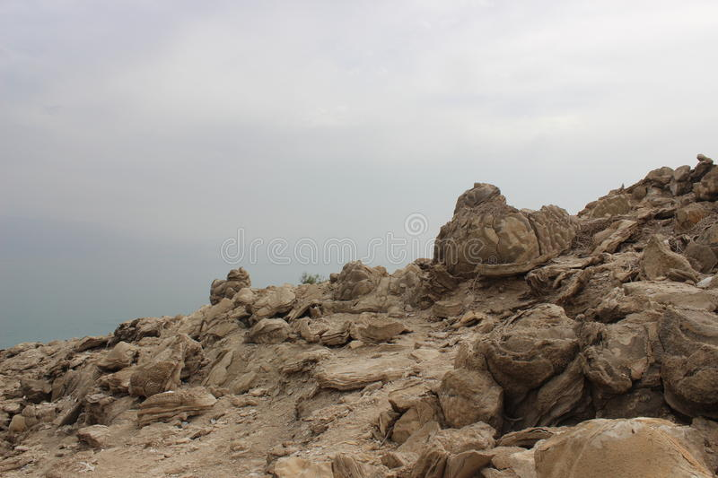 Rocks by the shore of the Dead Sea in Israel royalty free stock photos