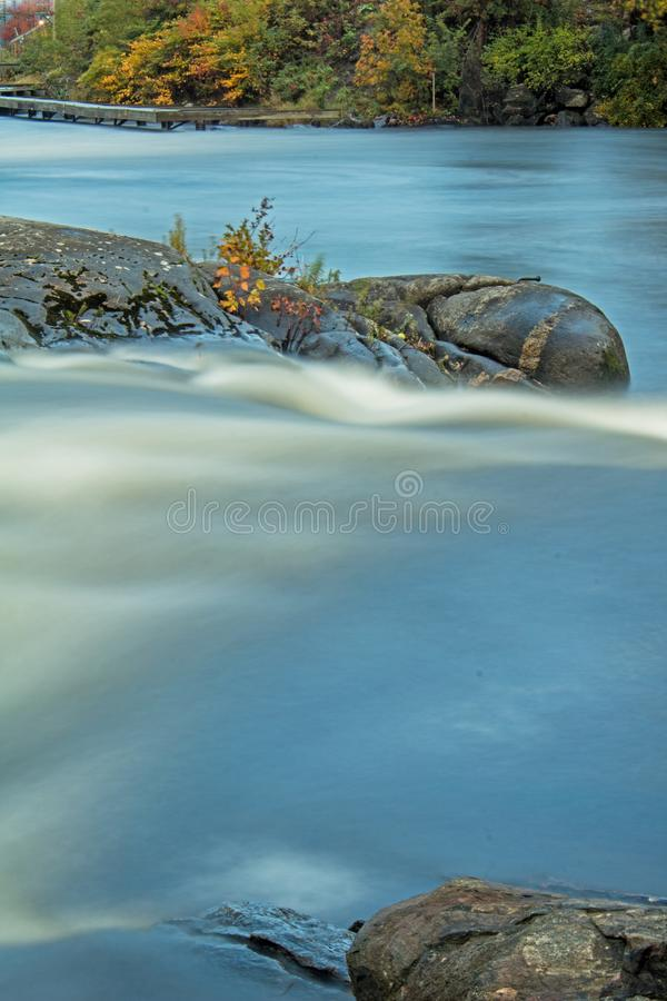 Free Rocks Sit Solid Against The Turbulent Waters Of The Seguin River Royalty Free Stock Image - 129938036