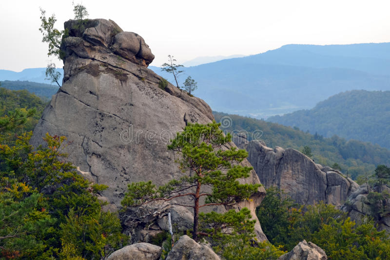 Rocks, sky, mountains an forest stock image