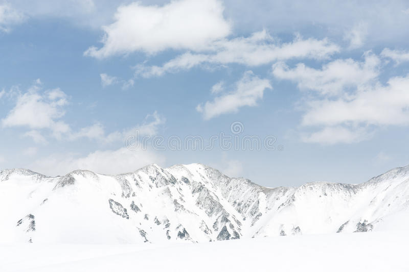 Rocks on the snow covered mountain under blue sky. Japan royalty free stock photography