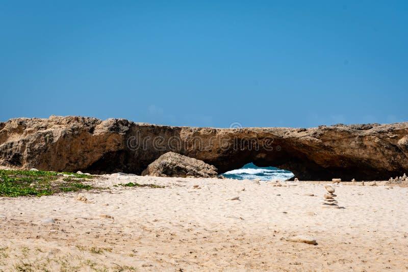 Natural bridge formation in Aruba`s north coast stock photo