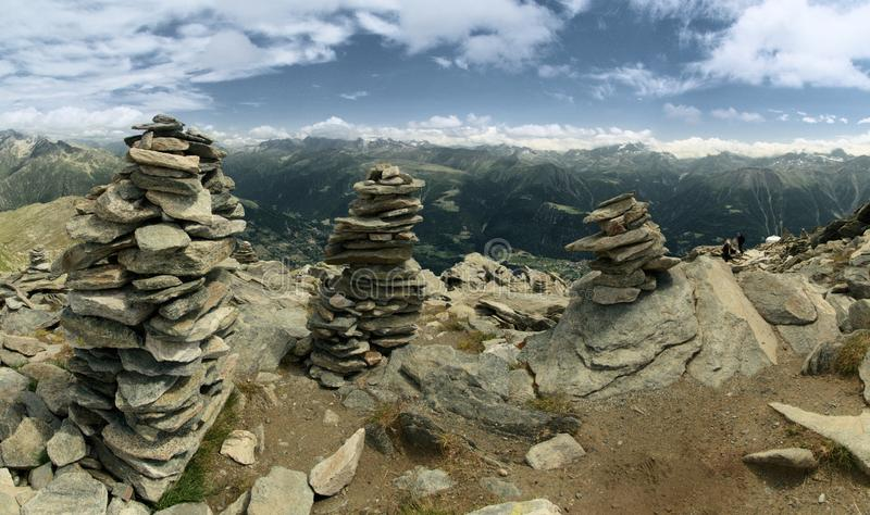 Rocks stacked on the peaks; terrain next to Eggishorn station. Rocks stacked near the cable-car station at Eggishorn, Valais in the Swiss Alps stock photo