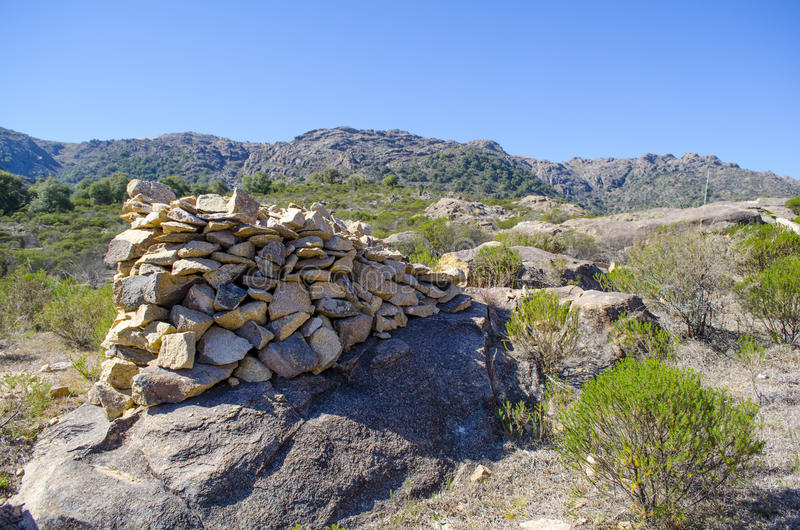 Rocks stacked on a rock. Mountainous region. Rocks stacked on a rock surrounded by vegetation stock images