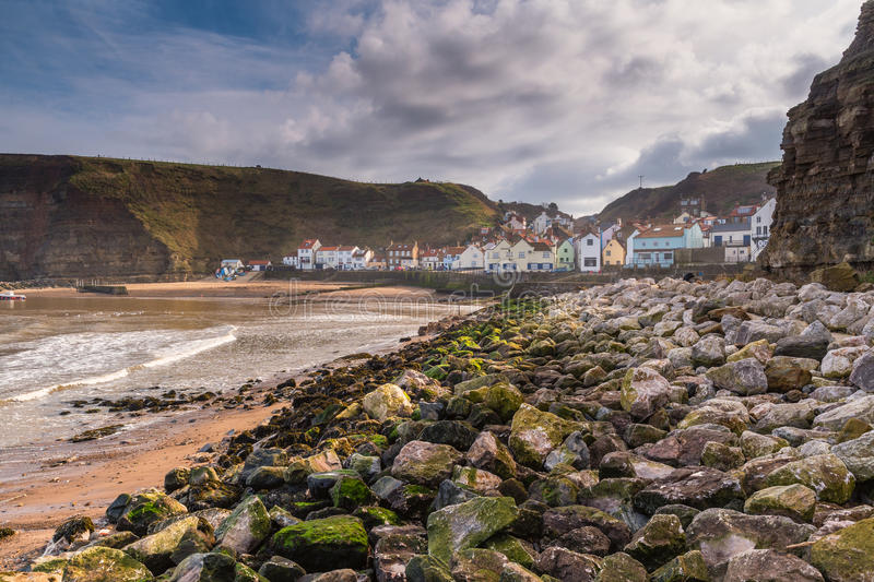 Rocks in Staithes Harbour stock photo