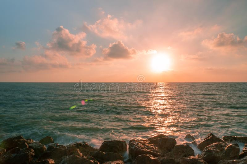 Sunset with a sailor at Tel Aviv, Israel royalty free stock photo