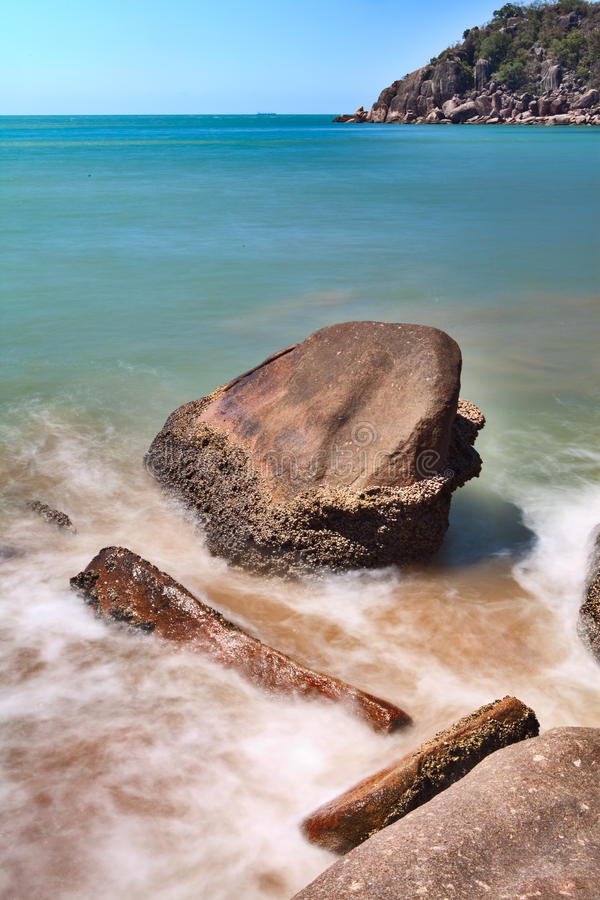 Rocks In Surf On Beach Royalty Free Stock Photography