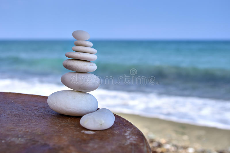 Rocks on a table. Perfectly balanced white rocks on a table stock photo
