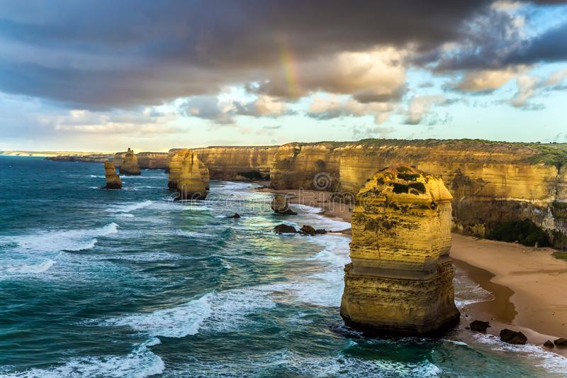 The rocks Twelve Apostles in an ocean storm surf. Travel to Australia. Fantastic morning light on the Pacific coast about. Melbourne. Concept active and stock photos