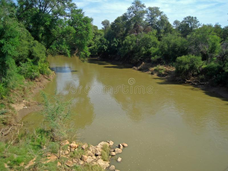 ROCKS AND VEGETATION ON THE BANKS OF THE LIMPOPO RIVER, SOUTH AFRICA. View of the Limpopo river at the Northern border between South Africa and Botswana royalty free stock photo