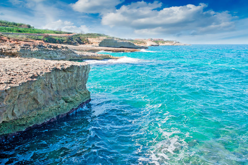 Blue water and cloudy sky stock photography