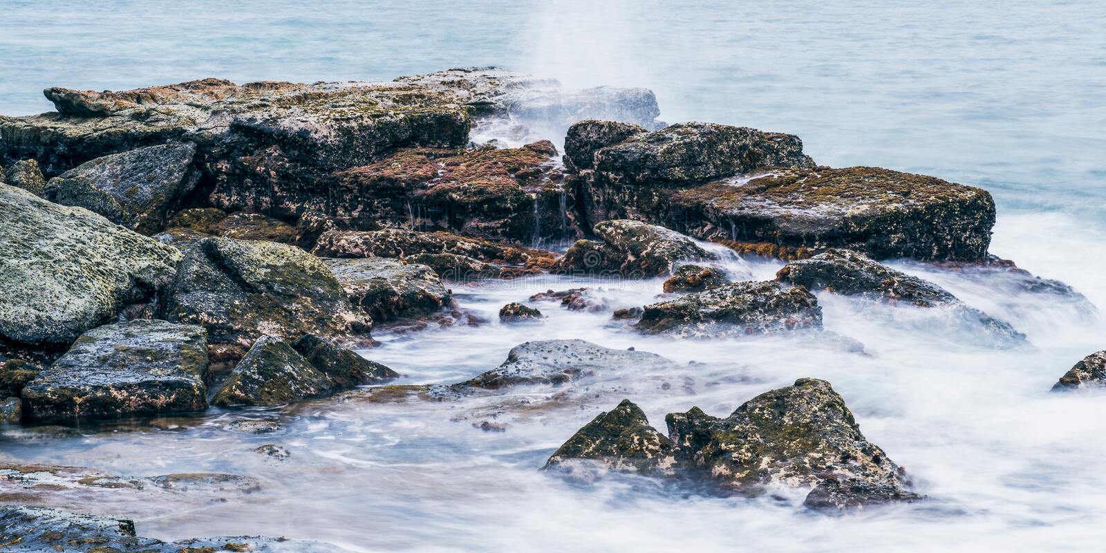 Rocks and waves at Point Cartwright royalty free stock photos
