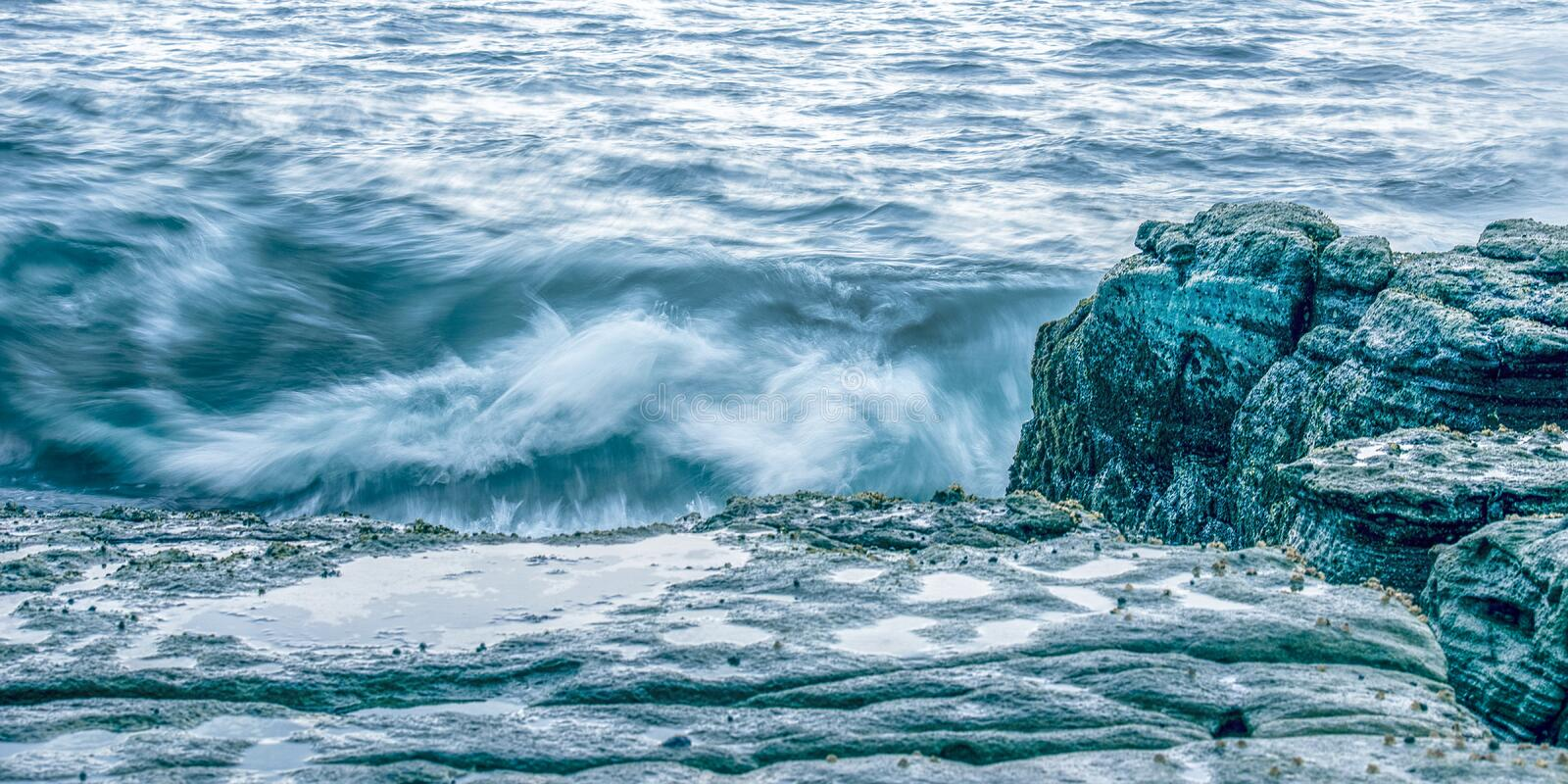 Rocks and waves at Point Cartwright royalty free stock images