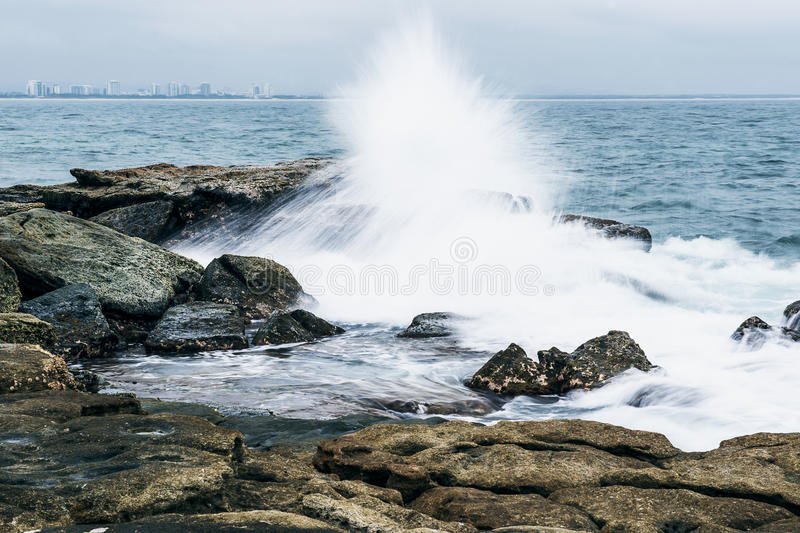 Rocks and waves at Point Cartwright stock image