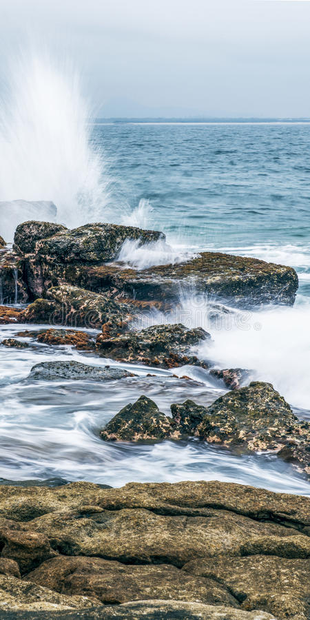 Rocks and waves at Point Cartwright royalty free stock photo