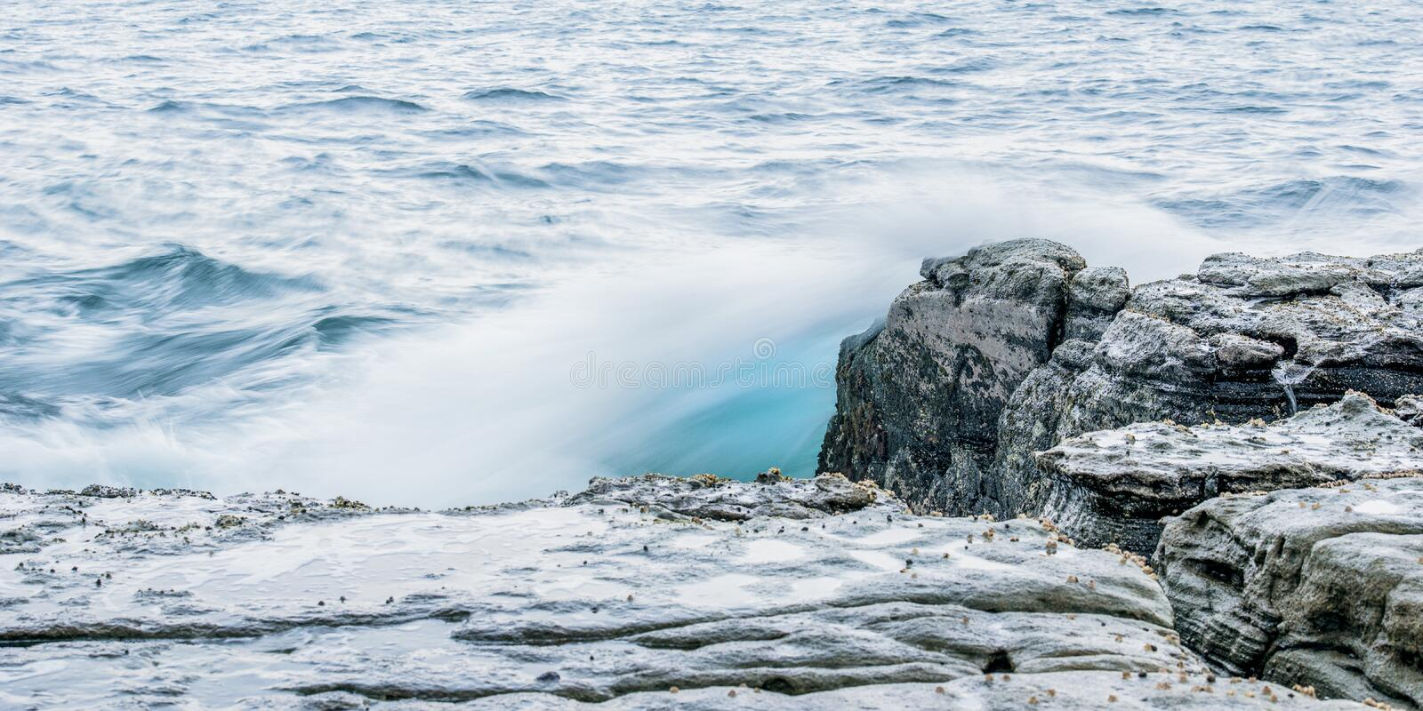 Rocks and waves at Point Cartwright stock photos