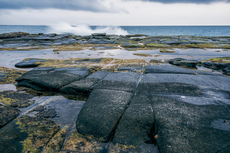 Rocks and waves at Point Cartwright royalty free stock image
