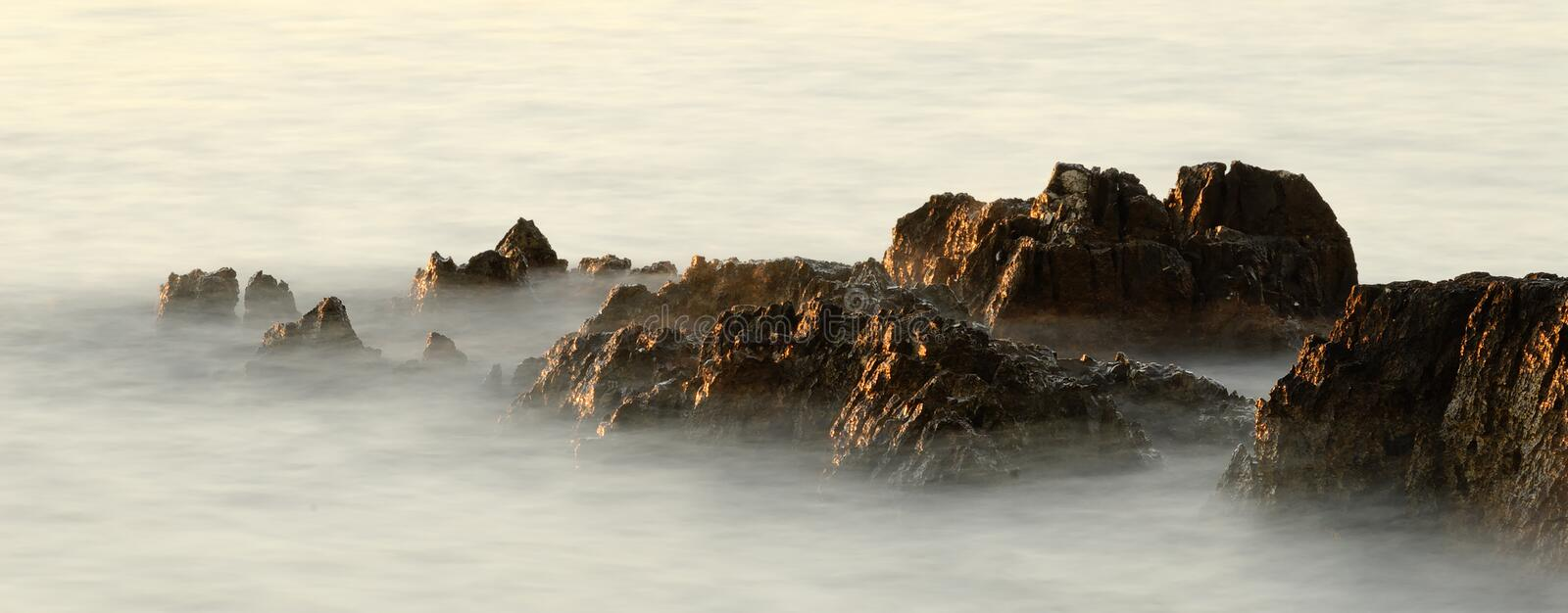 Download Rocks In The Waves In The Sunset Stock Image - Image of theme, panorama: 6175659