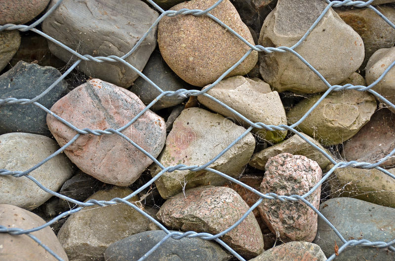 Rocks with wire fence