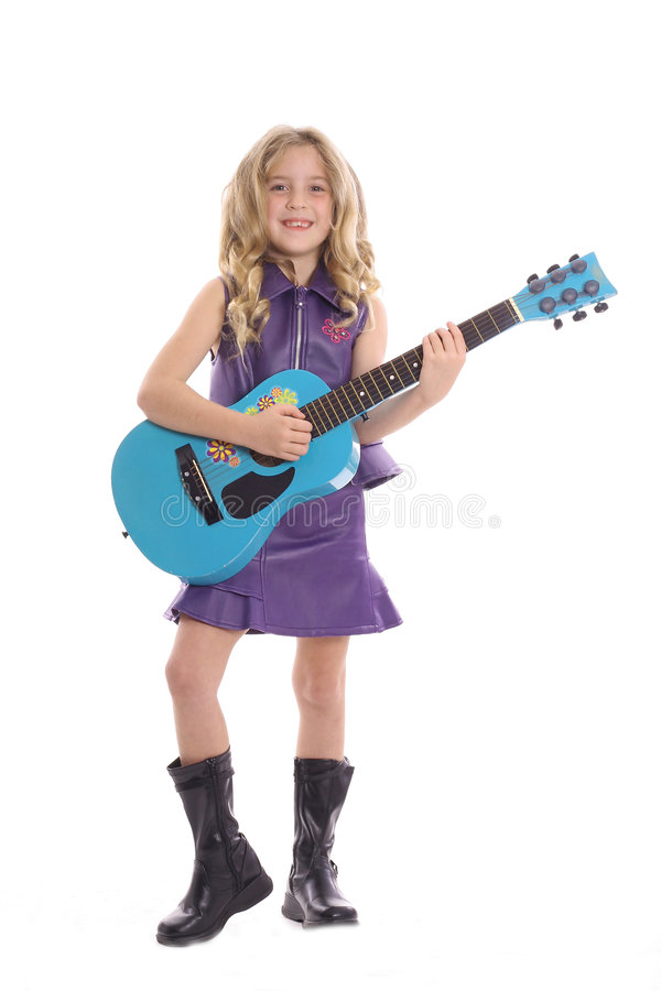 Rockstar child playing guitar royalty free stock photo
