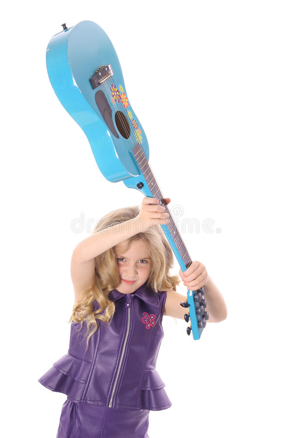 Rockstar child smashing her guitar peek stock photos