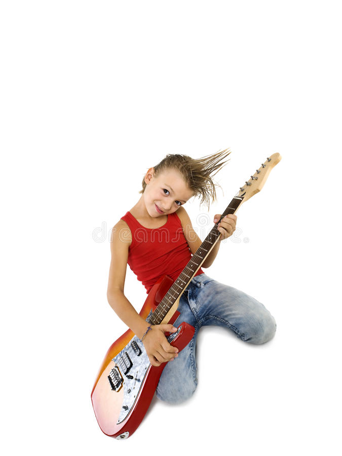 Rockstar kid with a guitar. Rockstar kid with electric guitar stock photography