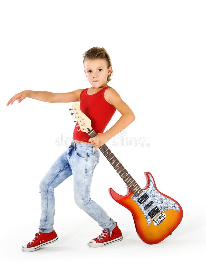 Rockstar kid with guitar. Rockstar kid with electric guitar stock image