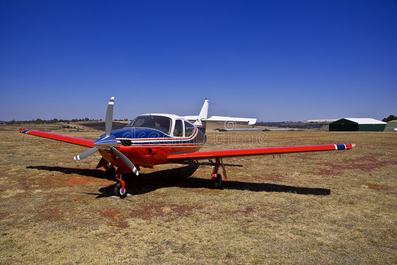 Rockwell Commander 112A. High speed single engined light aircraft [Rockwell Commander 112A], fitted with a three bladed prop. Seen in the background are some royalty free stock photo