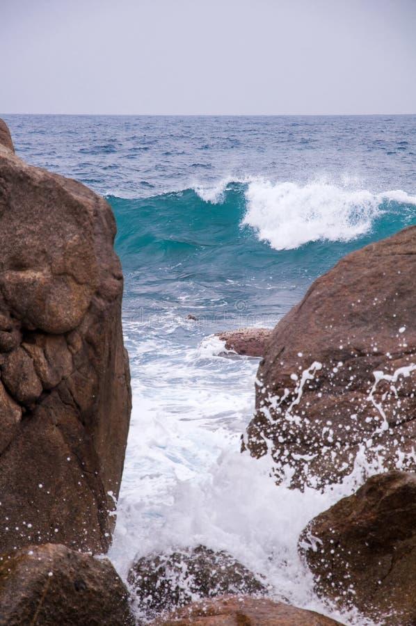 Free Rocky Beach And Beachcomber Royalty Free Stock Photo - 49947455