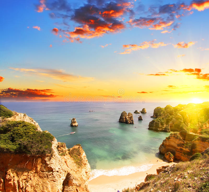 Free Rocky Beach At Sunset, Lagos, Portugal. Counter Light Stock Photos - 60892203