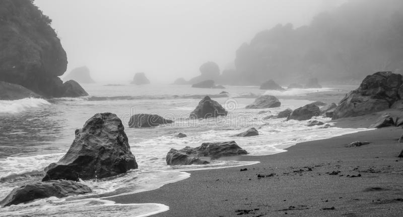 Rocky Beach black and white coast ocean. Front view stock photo