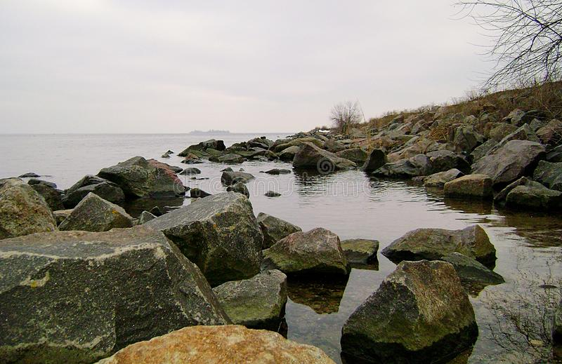 Ochacov. Winter Black Sea. Rocky beach. Boulders of granite on the shore of the Black Sea. Rocky beach. Boulders of granite on the shore of the Black Sea royalty free stock photo