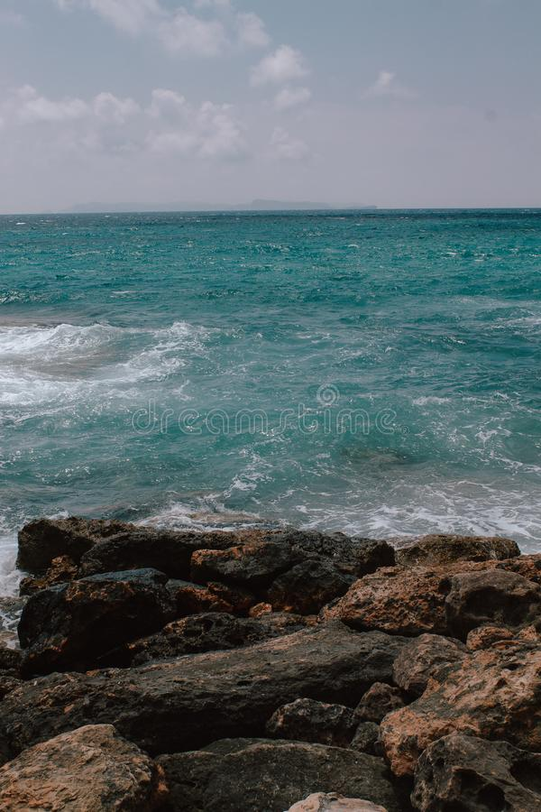 Rocky beach in Mallorca, in summer at high tide with the waves hitting and breaking on the coast.Rocky beach in Mallorca. Rocky beach in Mallorca, in summer at stock photography