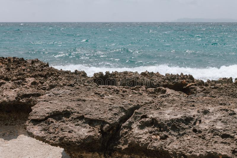 Rocky beach in Mallorca, in summer at high tide with the waves hitting and breaking on the coast.Rocky beach in Mallorca. Rocky beach in Mallorca, in summer at royalty free stock images