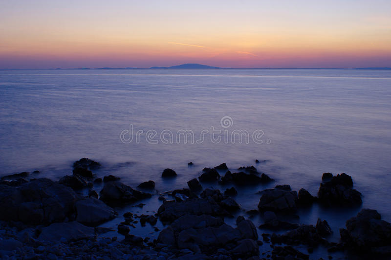 Rocky Beach on Pag Island after Sunset. Rocky beach near tourist resort of Novalja on island of Pag in Croatia after sunset royalty free stock image