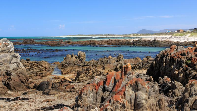 A rocky beach - Pearly beach - South Africa. Pearly Beach is a remote seaside hamlet in Overberg District Municipality in the Western Cape Province of South royalty free stock images