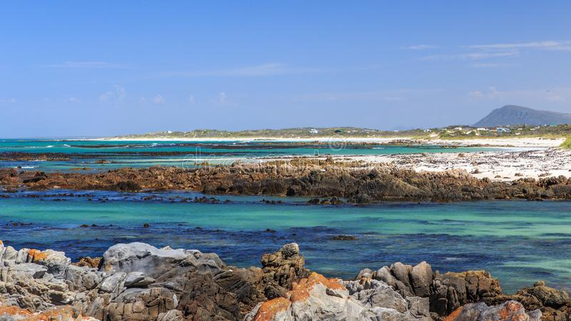 A rocky beach - Pearly beach - South Africa. Pearly Beach is a remote seaside hamlet in Overberg District Municipality in the Western Cape Province of South royalty free stock photos