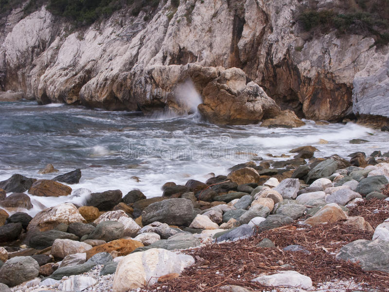 Rocky beach. Rough water over a rocky beach in Eastern Greece stock image