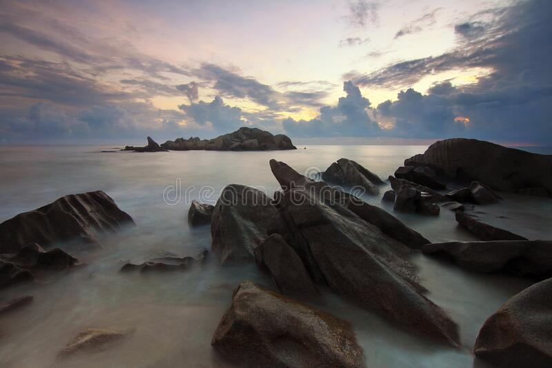 Rocky beach at sunset royalty free stock images