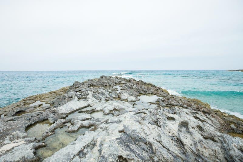 Rocky beach of Exuma, Bahamas. Rocky beach on waterfront of Exuma, Bahamas on sunny day stock image