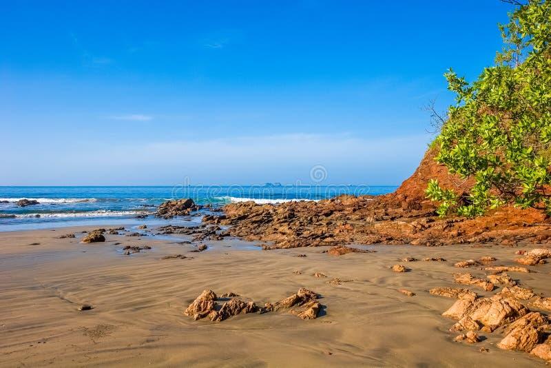 Rocky Beach Wet Sand photo stock