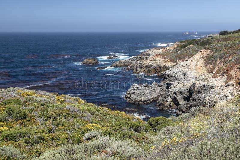 Rocky Big Sur Coast - California. The beauty of California's Big Sur coast is seen as waves break on its rugged and rocky shoreline royalty free stock photo